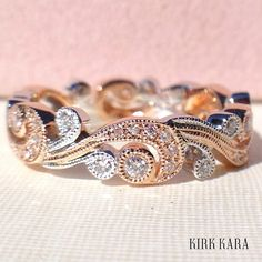 Kirk Kara's Angelique diamond band in rose gold with white gold details.