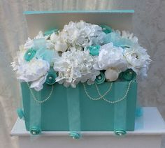 Silk floral arrangement in Tiffany blue box. I used for dessert table set up on a pedestal...www.facebook.com/candicecreations