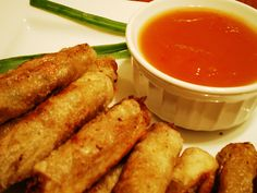 Lumpiang Shanghai Ingredients  2 lbs ground pork  1/2 cup green onions  1 cup carrots  1 cup onion  2 tsp soy sauce  1 raw egg  1 tsp salt  2 tsp ground black pepper  Lumpia wrapper (Spring roll skin)
