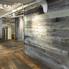 Antique Barn Wood Siding Created The Cool Reclaimed Wall Paneling In This Office