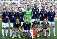 French national team members, Top row L-R: midfielder Camille Abily, midfielder Elise Bussaglia, midfielder Kenza Dali, goalkeeper Sarah Bouhaddi, defender Wendie Renard, defender Laura Georges, and Gaetane Thiney. Bottom L-R: defender Jessica Houara D'Hommeaux, forward Eugenie Le Sommer, midfielder Louisa Necib and defender Laure Boulleau pose during a Group F match at the 2015 FIFA Women's World Cup between France and Colombia at Moncton Stadium, New Brunwick on June 13, 2015. AFP PHOTO
