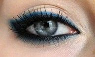black rimmed, smokey navy eyes