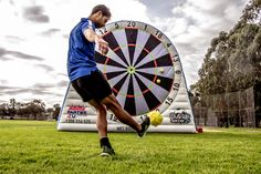 Soccer Darts is sweeping Australia. Launch the fluffy ball at a giant velcro board and try and score 180!!