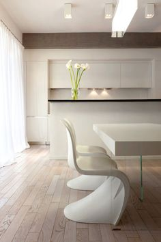 White on white with a side of cala lilies | Pan Apartment by Carola Vannini Architecture