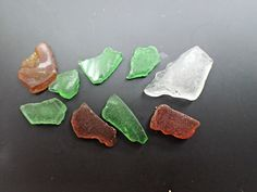 This set of 8 pieces of sea glass varies in size and color.  The set includes green, brown, and white pieces.  These pieces have not been as tumbled in the ocean as well as some other pieces, so they still have a noticeable amount of shine.  Some pieces have other imperfections, as seen in the photos.Sometimes, the sea glass is found by beach combing. More often I find the pieces of beach glass in the water.  All pieces were found at one of the many beaches in Oahu, Hawaii.  These pieces of…