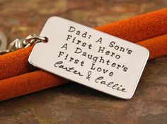 Personalized Key Chain - Aluminum dog tag Hand Stamped Keychain - Dad, A son's first hero, a daughter's first love. $25.00, via Etsy.