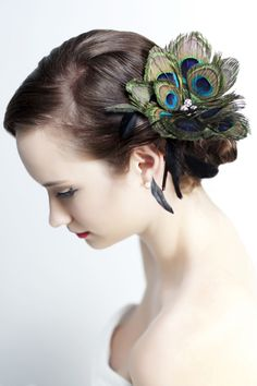 Beautiful feather addition to a cute hair style.