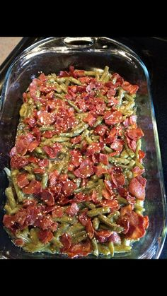 CRACK GREEN BEANS 5 regular cans of green beans, drained (note: you can substitute a similar amount of frozen green beans, about 4 (12-ounce) bags, thawed, or you can use fresh green beans, too) 12 slices bacon 2/3 cup brown sugar 1/4 cup butter, melted 7 (freshly baked brown sugar)