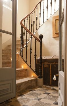entry Stone staircase, large trunk, large french doors, beautiful via:The Faith, The Heart, and The Art