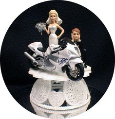 Beautiful porcelain bride and groom couple with their awesome Suzuki Bike. Wonderful detailing  Very fun.  6 inches tall. Mounted on 4 3/4 inch