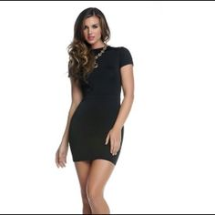 """Black Exposed Backside Mini Dress #884561-BLAM Short sleeve bodycon dress with large backside cutout. 92% Polyester 10% Spandex. Bust 32"""", waist 26"""", hips 30"""", length armpit down 23"""". Blvd Collection Dresses"""