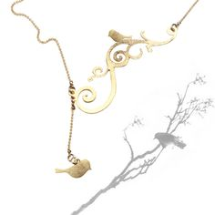 Twig necklace, bird on a branch with a dangling bird, Gold plated twig necklace