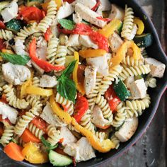 Garlic Parmesan Pasta with Chicken & Roasted Bell Peppers Recipe Main Dishes with rotini, carrots, zucchini, red bell pepper, orange bell pepper, yellow bell pepper, olive oil, chicken broth, garlic cloves, grated parmesan cheese, fresh basil, oregano, salt, pepper, chicken breasts