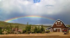 Beautiful barn and lucky rainbow at C Lazy U in Colorado.