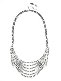 We are seriously digging the deliciously deco vibe of this stunning statement bib.  With rows of draped crystals all set against dark hematite, it's the perfect finishing touch to any holiday look.