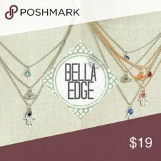 Evil eye hamsa protection gemstone layer necklace The evil eye is a curse believed to be cast by a malevolent glare, usually given to a person when they are unaware. Many cultures believe that receiving the evil eye will cause misfortune or injury. The hamsa is an amulet for protection from the envious or evil eye.  This stylish cascade layered necklace features rhinestone detailing on the protective symbols of the evil eye and hamsa. Your choice of silver/aqua, silver/sapphire and gold/red…