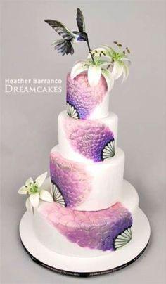 Purple hummingbird wedding cake