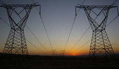 Photo: Eskom power lines run through an open field as the sun rises on a cold winters day in Johannesburg, South Africa, 08 June 2015. EPA/KIM LUDBROOK