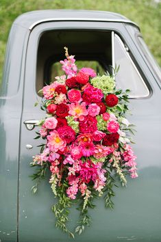 fuchsia flowers - photo by Natalie Franke http://ruffledblog.com/vintage-hot-air-balloon-wedding