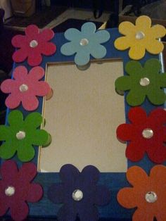 Fly-up gift for my Daisy Girl Scouts. Picture frame with flowers around the edge painted in the petal colors.
