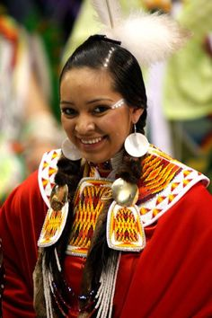 Native American Indian..she's so beautiful and wholesome. The younger generation of girls, women, keep their hair up with a beautiful barret , feather tuft stuck in, on top. Mainly,it keeps their hair out of their face while dancing..and regalia/appearance has points in most pow-wows.