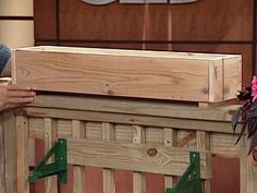 Add style to your deck by building planter boxes to sit on top of the railing. This is a great project for a beginner woodworker.