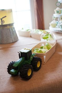 A John Deere tractor towing berry baskets - SUCH a cute idea!! (baskets are from Garnish)