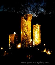 Chinese Basalt stone water fountain with LED lighting set in the top of each column.   Magical!