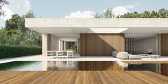 On the opposite side of the house, a large cantilever of white concrete frames the pool and the garden.