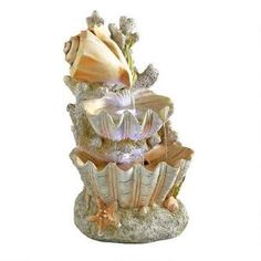 Ocean's Bounty Cascading Shell Garden Fountain Was: $169.00           Now: $129.00