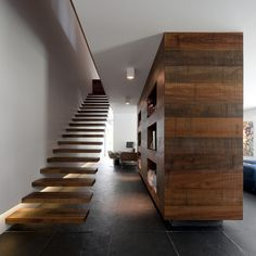 Reclaimed wood + floating stairs.