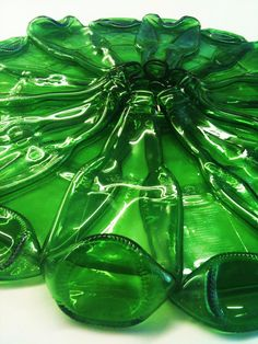 Slumped bottles 1/2 slumped then laid 2nd 1/2 on space between first bunch. Great wreath shape