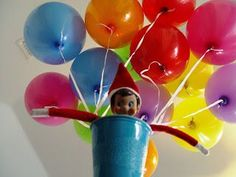 Our elf arrived by balloon transport one morning!Elf on the Shelf ideas #elfontheshelf