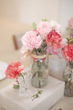 Carnation Centerpieces in Mason Jars- less expensive. blush, white and some rosemary or thistle?