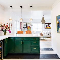 Stunning kitchen transformation with painted floors, cabinets, and colorful art.