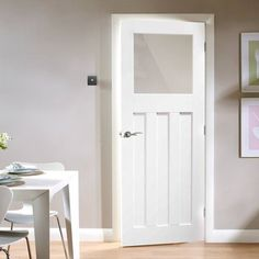 A classic white primed 1930s style door with flat panels and glazed with Obscure glass. #1930doors #directdoors