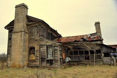 This abandoned house in the Missouri Ozarks is much bigger than the usual house.  May have been a hotel or a boarding house.  Photo credit:  Mary Koch.