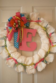 Cute diaper wreath. I like all the colorful ribbons