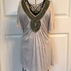 Light Gray beaded blouse Beaded neckline. Flowy sleeves. Very soft material. Color is a light gray and beading is pewter. Daytrip Tops Blouses
