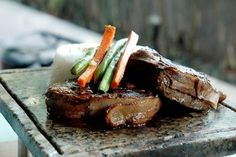 Salpicao Medallion - Certified Angus Beef wrapped in bacon and served on a sizzling hot stone slab.