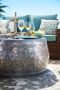 Handcrafted from powder-coated metal in a rich, silvery finish, Pier 1's Avan Round Silver Coffee Table adds exotic intrigue to your patio or living area. Not to spoil the mystery, but it doubles as extra seating, too!