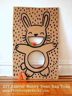 DIY Easter Bunny Bean Bag Toss game with carrot bean bags from Pink Stripey Sock. - DIY Easter Bunny Bean Bag Toss game with carrot bean bags from Pink Stripey Sock. Easter Party Games, Easter Games For Kids, Easter Birthday Party, Bunny Party, Bunny Birthday, Cool Games For Kids, Fun Easter Ideas, Diy Easter Bags, Easter Crafts Kids