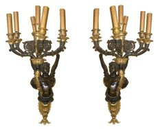 This magnificent pair of sconces date from the third quarter of the 19th century, and feature cherubs holding candelabra in the style of Andre Antoine Ravio (1759-1814), the noted bronzier and artist who served the crown and court during the first empire.