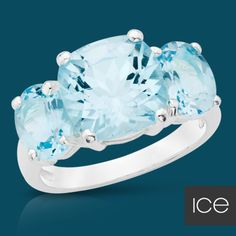 Blue Topaz Sterling Stunner...I would settle for just the center stone on a band, it doesn't have to be all 3!