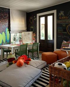 Chalkboard wall, white table, floor pillows
