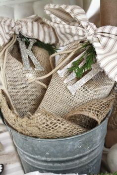Burlap gift bags tied w/ glitter letters.