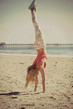 Handstands on the beach!(:...... Also love the outfit