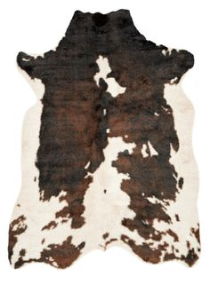 You could add some Colorado theme to your office with a faux Cowhide rug in brown, or black or tan. You can totally mix this style with simple office chairs and a chic mirror too! (various sizes and prices on Lulu & Georgia. Also since it is faux, don't have to feel bad for animals) $159 - $379