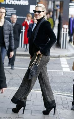 Hot to trot: Kate Moss cut a sophisticated figure in grey trousers and towering patent leather boots for a casual lunch at Sexy Fish restaurant on Wednesday