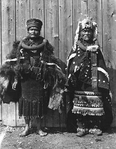 Gitksan Chief Gwas-hlaa'm and 'Wii-l'itsxw, wearing ceremonial dress and headdresses, Kitwancool, British Columbia, 1910 :: American Indians of the Pacific Northwest